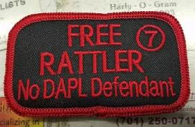 """Free Rattler"" sew and iron-on patches. 7 represents the next 7 Generations, the 7 Council Fires of the Oceti Sakowin, and the 7 Sacred Rites of the Lakota. Donation request: $10. [Credit: Michael Rattler Markus]"