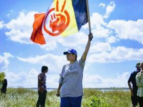 Cante Waste Win (Good Hearted Woman); RedFawn with AIM flag -photo credit Liminal Films