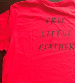 Back of Little Feather's NoDAPL shirts. The letters were made to resemble leaking oil. Donation request:  $30 [Art credit: Michael Little Feather Giron]